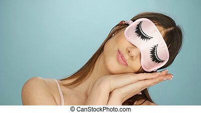 Fun woman relaxing in a sleep mask - Fun woman relaxing in a...