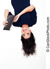fun woman using tablet computer upside down