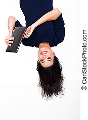 fun woman using tablet computer upside down