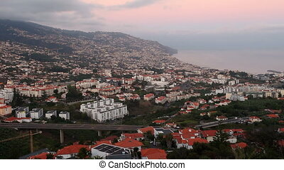 Funchal aerial panoramic sunset view timelapse. Funchal is...