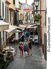 Shops, bars and restaurants in Santa Maria Street in Funchal...
