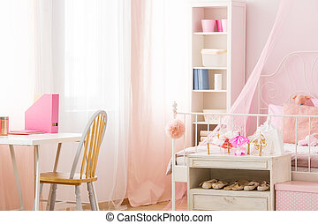 Functional pink room with bed