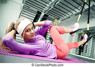 Functional training - Young woman stretching muscles...
