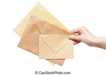 fundo, isolado, amarela, mão, envelopes, branca