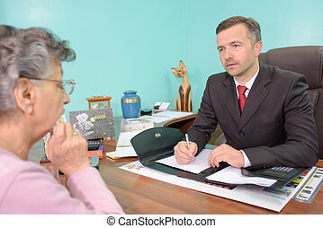 funeral director with elderly woman