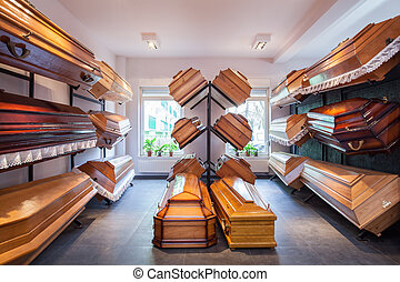 Funeral home with plenty of different coffins