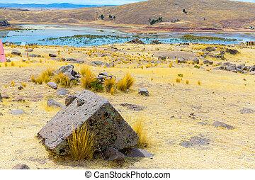 Funerary towers and ruins in Sillustani, Peru, South America- Inca prehistoric ruins near Puno, Titicaca lake area.