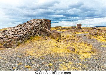 Funerary towers in Sillustani, Peru, South America- Inca prehistoric ruins near Puno, Titicaca lake area.