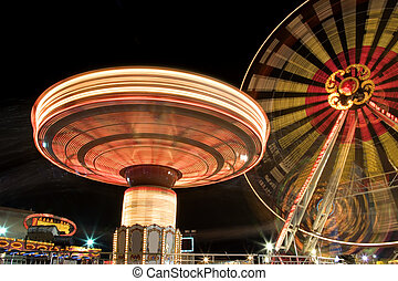 Funfair at Night - Image of a funfair ground at night in...