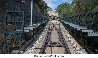 Funicular transportation in Barcelona tunnel. Speed road,...