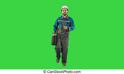 Funky and successful engineer, manager or architect dancing and having fun on a Green Screen, Chroma Key.