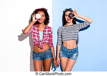 Funky couple. Creative concept of beautiful sexy girls