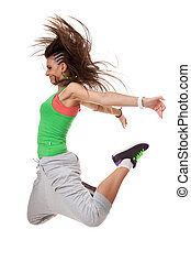 Side view of a modern woman dancer with a funky hairdo jumping with knees bent and hands back