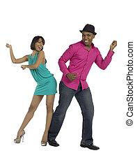 funky dancers - Joyful couple performing a funky dance