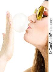 Funky girl blowing balloon. - Fun leisure people concept....