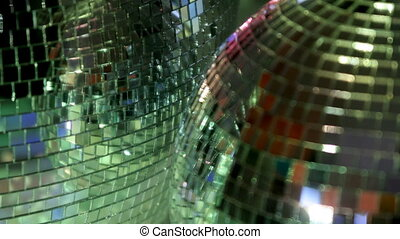 funky glitterball spinning with patterns of light