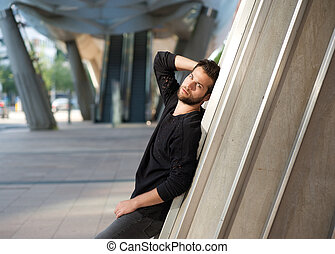 Funky male fashion model standing outdoors