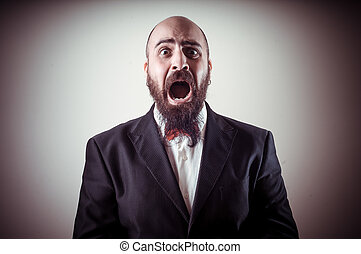 funny afraid elegant bearded man on vignetting background