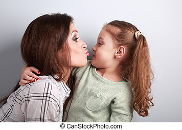 Funny amusing young mother wanting to kiss her comical...