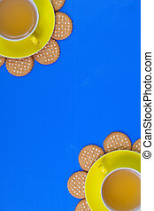 Funny arrangement cups of tea on blue wooden table with...
