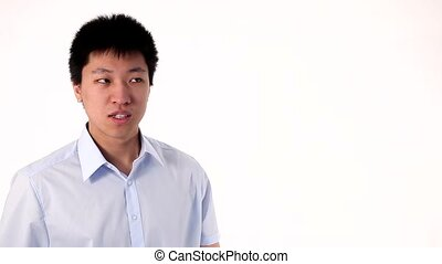 Funny Asian man pointing on a white
