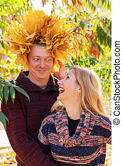 Funny autumn portrait of husband and wife