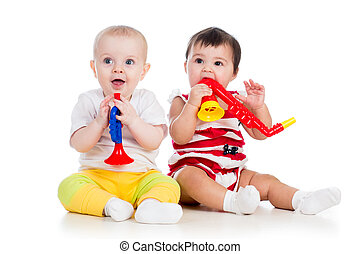 Funny babies girls  with musical toys. Isolated on white background