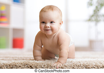 funny baby boy crawling on floor at home