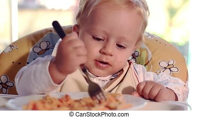 funny baby eating pasta
