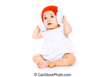 Funny baby in hat sitting