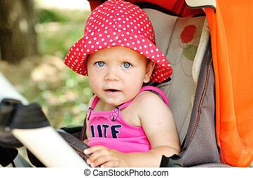 funny baby in stroller
