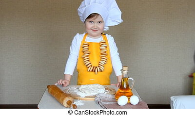 Funny baby in the role of cook kneads dough - Funny baby in...