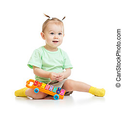 funny baby playing with xylophone isolated