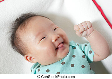 Funny baby smile face close up