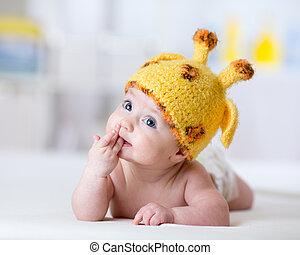 funny baby weared giraffe hat