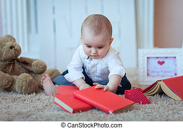 Funny baby with books
