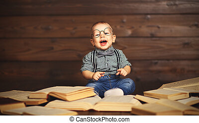 funny baby with books in glasses