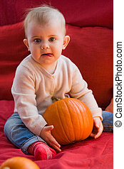 Funny baby with pumpkin