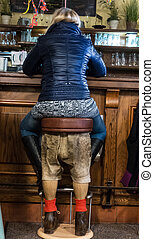 funny barstool - a woman sitting on a bar stool funny
