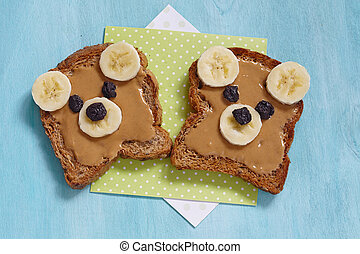 Funny bear face sandwich with peanut butter, banana and...