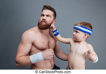 Funny bearded dad and his son fighting - Funny bearded dad...