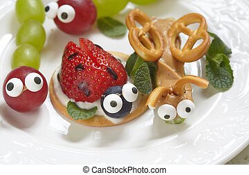 Funny beetles from grapes, berries and pretzels