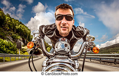 Funny Biker in sunglasses and leather jacket racing on ...
