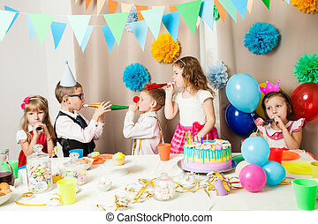 Funny birthday games - Group of smiling children playing on...