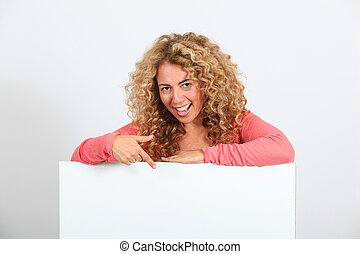 Funny blond woman holding whiteboard