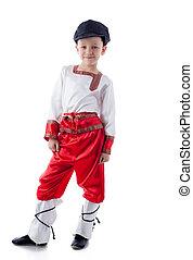Funny blonde boy posing in rustic costume