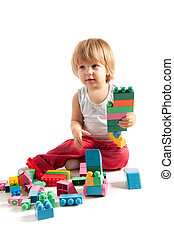 Funny boy playing with blocks