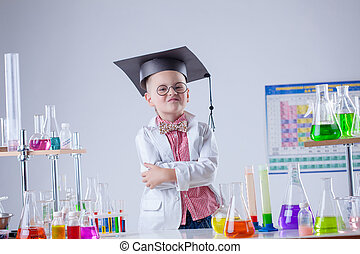 Funny boy posing as chemist in chemical laboratory