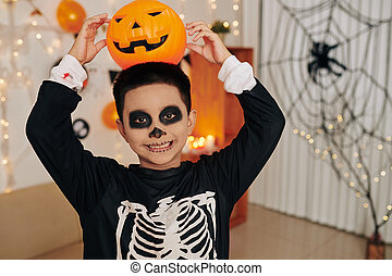 Funny boy posing with jack o lantern