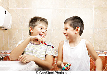 Funny boys with toothbrushes